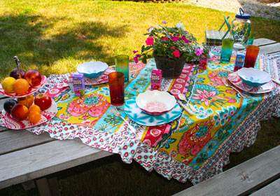 We pay as much attention to staging outside, as we do the inside. <em>Joie de vivre</em> displayed in this <em>ein plein air</em> picnic table setting.