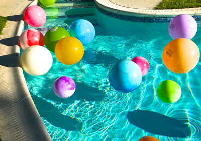Colorful pool balls bring life to this expanse of Cerulean blue.