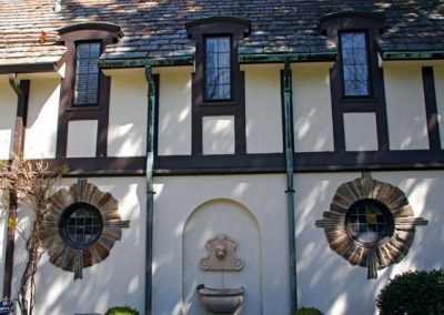 Houston Barnard neighborhood, Brighton, NY - Exquisite circular stone surrounds stained glass windows.