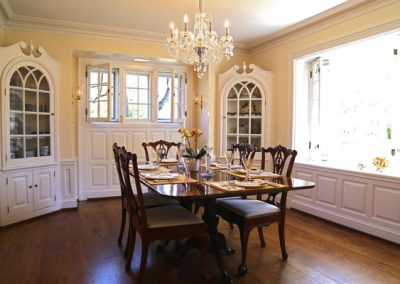 Opening the windows of this traditional dining room brings fresh air and a positive feeling to this gorgeous formal dining room.