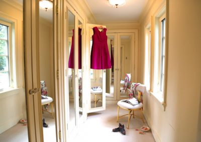 We added a golden chair, opened mirrored closets and featured a shiny magenta taffeta dress to bring life to an otherwise blank canvas.