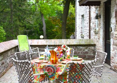 Brick patios are so much more inviting when the table is set with fun mix and match patterns, textures and colors.
