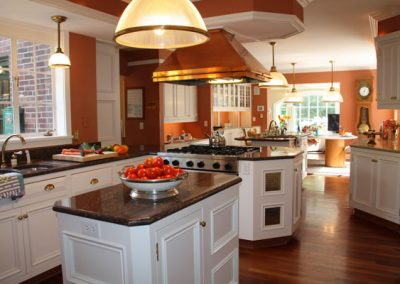 Fresh-from-the-vine tomatoes and home grown vegetables on a cutting platter, highlight the ample counter tops for cooking and professional flow of the kitchen. Pasta and home cooked sauce for dinner tonight!