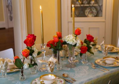 Elegance abounds is this historic dining room by use of vintage plates, collected at an estate sale.