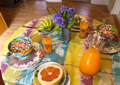 Cheery foods brighten this breakfast table.