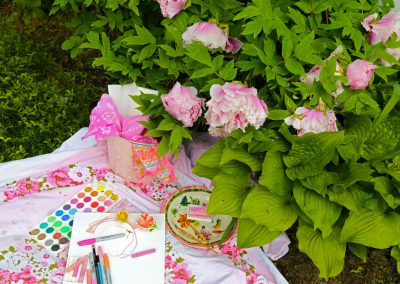 Watercolors set on a blanket outside for the <em>ein plein air</em> artist.