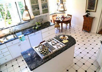 Kitchens are often the focal points of the home and the focal point of our staging. Counters have been cleared of clutter and artistic dish towels and vignettes of a summer meal are strategically placed.