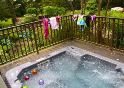 Hot tubs are enlivened with vibrant towels, bathing suits and balls.