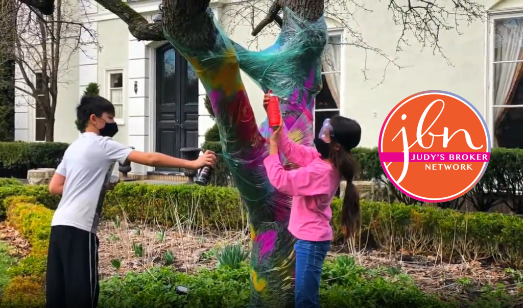 still frame from JBN video showing children decorating tree in Houston Barnard neighborhood